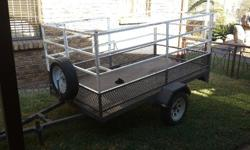 2.2 x 1.1 flatbed trailer. 1 m high sides. Gate swings