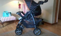 - Black and orange Graco travel system in excellent