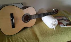 Brand new acoustic guitar with bag, guitar tuner,