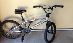 Hardly used haro trick bike with pegs for sale for
