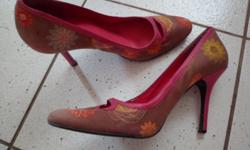 I am selling 2 pairs stylish high heel shoes in good