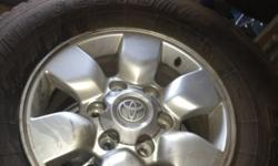4 x 15' Hilux wheels & tyres for sale. R4000 neg. Call