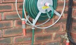 This wall mounted galvanised easy wind hose storage