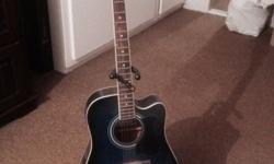 Blue Ibanez acoustic guitar, like new, hardly been