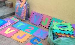 Over 50 colourful rubber interlocking letters/numbers.