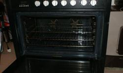 Kelvinator 90cm gas stove with electric oven for sale.