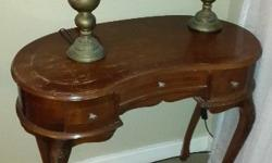 Brown kidney shaped dressing table with 3 drawers.