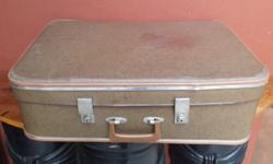 Large old brown suitcase. From the 1970's. Still in