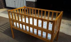 Large wooden cot with mattress.