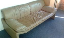 Contemporary design, 3 seat couch in tan leather. Good