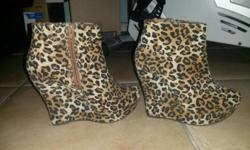 Size 4 leopard print heels for sale. Great condition.