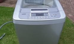 13 kg LG washing machine in pristine condition. one and