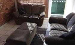 2x two seater couches with matching ottoman for sale.