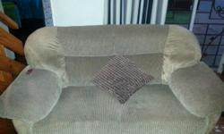 Brown material lounge suite for sale, well priced.