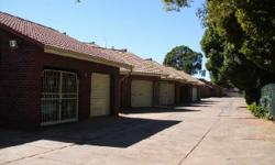 Lovely face brick duplex in secure area. Tile