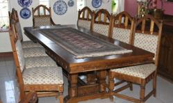 Lovely dark oak dining room table, ten chairs and