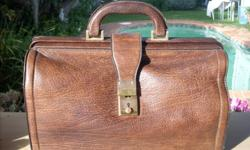 genuine leather brief case with seperate key. The case