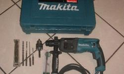 Makita HR 2230 22 mm SDS Drill in Case with some of SDS