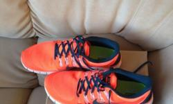 Mens Nike shoes for sale, bright orange in colour, size