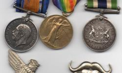 Military medals, badges, helmets, swords, bayonets,