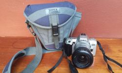 Minolta 404 Si Dynax camera & bag. Camera takes 35mm