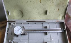 Stainless steel dial caliper set made by Mitutoyo of