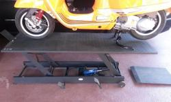 AS NEW MOTORCYCLE HYDRAULIC LIFT.