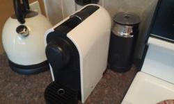 Nespresso UMilk machine, with built in milk frother. In