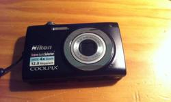 Brand new and barely used Nikon Coolpix 12mp camera in