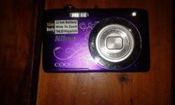 Purple Nikon CoolPix camera for sale, has hardly been