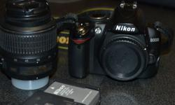 Nikon D3000 DSLR camera with 18-55mm lens for sale. In