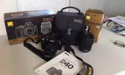 Nikon D40 plus 18/55 and 55/200 Nikkor lenses. All in