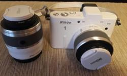 White. Twin lens kit. UV filters on both lenses. 8gb