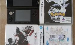 A black nintendo 3ds + 3 games. See photo.