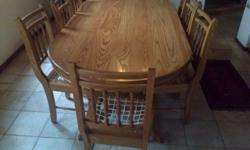 Beautiful light oak oval table and 8 riempies chairs.