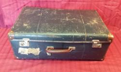 Old blue suitcase. Well, it was blue. This suitcase has