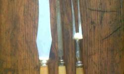 Old bone handled carving set. Still useable, no points