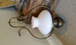Old brass light with white glass shade with no cracks