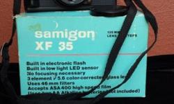 Old Samigon XF 35mm camera. In original box. Looks like