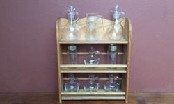 Old sauce rack. Included are salad dressing decanter,