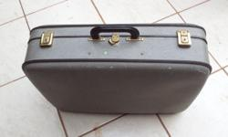 Old suitcase. Still structurally good, locks and hinges