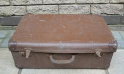 Vintage brown leather latchabe suitcase. Ideal to store