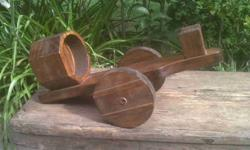 Old wooden wine bottle holder. Not only for wine, other