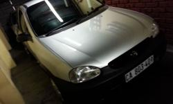Opel Corsa Colour: Metalic Silver Engine: 1.4i Year