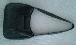 Beautifull ostrich leather hand bag. As good as new.