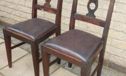Pair of dining chairs in original leather and timber in
