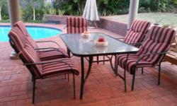 7 piece patio set with cushions. Table a bit rusted on