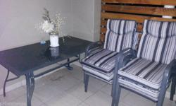 Stunning 7 piece Patio set for sale. (Table & 6