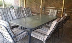 Large patio suite with eight chairs and cushions and