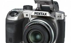New pentax, bought in the UK to use on trip. Used
